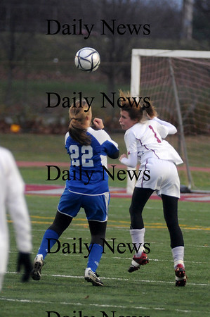 Lowell: Veronica Poirier goes up for a header with a Bedford player during  their game  at Crowley Stadium in Lowell. The Clippers beat Bedford 2-1 in OT  giving them their 3rd straight North Sectional Title. photo by Jim Vaiknoras/Newburyport Daily News Sunday November 16, 2008