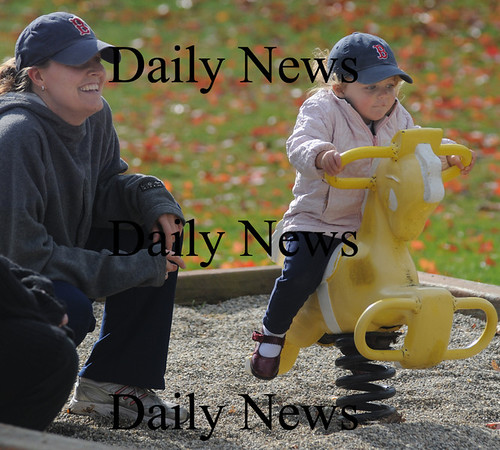 Amesbury:Audrey Flynn, 2, ride a pony at Amesbury Park much to the delight of her mom Kim Sunday afternoon. photo by Jim Vaiknoras/Newburyport  Daily News. Sunday November 8, 2008