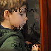 Newbury: Luca Moscardini, 3, looks at a display case filled with airplane models at the Plum Island Airport. Luca was one of about 10 kids from the Farm Friends program at the Spencer Pierce Little Farm  who visited the airport to learn about airplanes.Friday morning. photo by Jim Vaiknoras/Newburyport Daily News. Friday November , 14, 2008