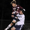 Wilmington:Tyler Stotz goes up for a header  with a Wilmington player during their game at Wilmington sunday night. photo by Jim Vaiknoras/Newburyport Daily News. Sunday November 9, 2008