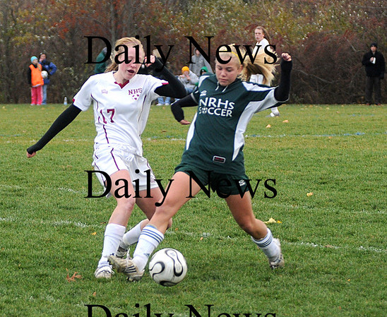 Newburyport: Newburyport's Avery Cullinan fights for the ball against  North Reading Tuesday at Cherry Hill in Newburyport. The Clippers won the game 2-0.photo by Jim Vaiknoras<br /> /Newburyport  Daily News. Sunday November 8, 2008