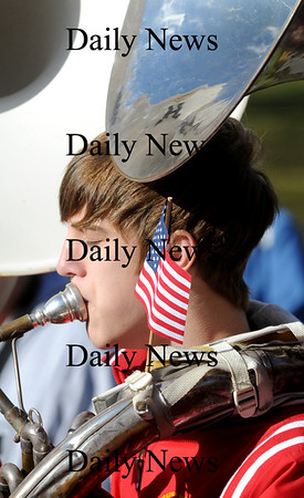 Amesbury:Amesbury High School sophmore Garrett King plays the sousaphone at the Amesbury Veteran Day ceremony at the Middle School Tuesday.photo by Jim Vaiknoras/Newburyport  Daily News. Sunday November 8, 2008