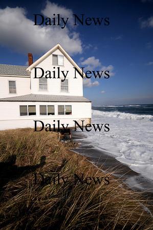 Newbury: Waves under cut sand at house on Plum Island causing it to tilt towards the ocean. photo by Jim Vaiknoras/Newburyport Daily News, Wednesday November 26, 2008