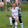 Newburyport:Newburyport's Micaela Hogan makes a play on the ball against North Reading at Cherry Hill. Newburyport won teh game 2-0.photo by Jim Vaiknoras<br /> /Newburyport  Daily News. Sunday November 8, 2008