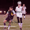 Lynn: Newburyport's Linddsey Tomasz heads the ball aqainst Lynnfield at Manning Field in Lynn Thursday night.The Clippers won the game 1-0.photo by Jim Vaiknoras/Newburyport Daily News. Thursday November 13, 2008.