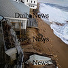 Newbury: Waves under cut sand at house on Plum Island causing it to tilt towards the ocean. photo by Jim Vaiknoras/Newburyport Daily News, Wednesday November 26, 2008