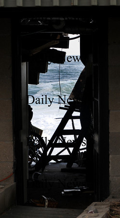 Newbury: The ocean is seen through the basement of a home on Plum Island. Waves under cut sand at house on causing it to tilt towards the ocean. photo by Jim Vaiknoras/Newburyport Daily News, Wednesday November 26, 2008