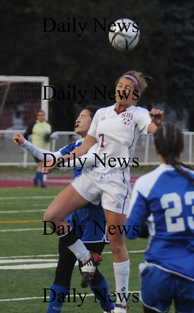 Lowell: Jillian Kinter goes up for a header with a Bedford player during  their game  at Crowley Stadium in Lowell. The Clippers beat Bedford 2-1 in OT  giving them their 3rd straight North Sectional Title. photo by Jim Vaiknoras/Newburyport Daily News Sunday November 16, 2008