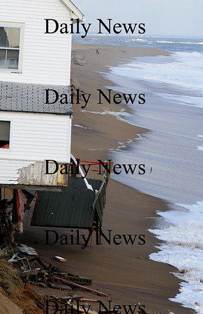 Newbury:  Waves under cut sand at house on causing it to tilt towards the ocean. photo by Jim Vaiknoras/Newburyport Daily News, Wednesday November 26, 2008