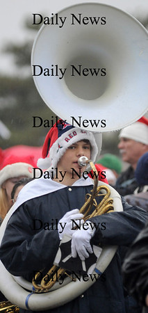 Newburyport:The Triton high marching band sousaphone player Tom Cookson marches to Market Square in the annual Santa Parade and Tree Lighting Sunday night.photo by Jim Vaiknoras/Newburyport Daily News.Sunday November 30, 2008