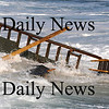 Newbury: A deck from a home on Plum Island crashes in the surf. Waves under cut sand at house on causing it to tilt towards the ocean. photo by Jim Vaiknoras/Newburyport Daily News, Wednesday November 26, 2008
