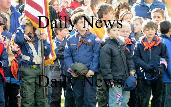 Amesbury:Cub Scouts hold flags and take off their hats during the National Anthem at the Amesbury Veteran Day ceremony at the Middle School Tuesday.photo by Jim Vaiknoras/Newburyport  Daily News. Sunday November 8, 2008