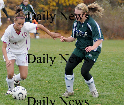 Newburyport: Newburyport's Micaela Hogan fights for the ball against  North Reading Tuesday at Cherry Hill in Newburyport. The Clippers won the game 2-0.photo by Jim Vaiknoras<br /> /Newburyport  Daily News. Sunday November 8, 2008