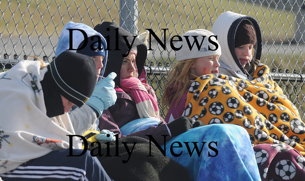 Holden: Newburyport girls youth soccer player try to keep warm as they watch the Newburyport high schoool girls team win their 2nd straight State Title Saturday 2-0 over Monson in Holden. photo by Jim Vaiknoras/ Newburyport Daily News. November 22, 2008