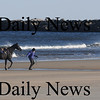 Salisbury: A horse and it's owner take a chilli stroll along Salisbury Beach Sunday afternoon.photo By Jim Vaiknoras/Newburyport Daily News. Sunday November 23, 2008.