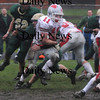 North Reading: Amesbury's Ryan Dragon breaks a tackle during the Indians  game at North Reading Saturday. photo by Jim Vaiknoras/Newburyport Daily News, Saturday November 15, 2008