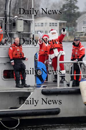 Newburyport:The Coast Guard brings in Santa and Mrs. Claus to the Newburyport waterfront in he rain Sunday night.photo by Jim Vaiknoras/Newburyport Daily News.Sunday November 30, 2008