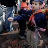 Newburyport:Aidan Kelly of  Newburyport Tiger Cub Pack 21 hands out flags at annual Veteran's Day ceremony  Tuesday at City Hall.photo by Jim Vaiknoras/Newburyport  Daily News. Sunday November 8, 2008