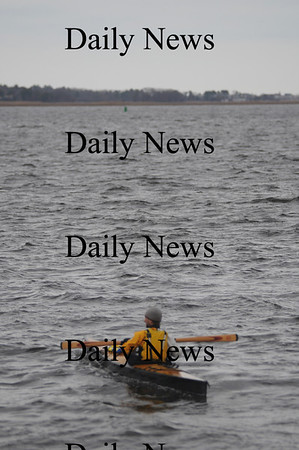 Newburyport:A kayaker heads out on Joppa Flats in Newburyport on a cold rainy Sunday afternoon.photo by Jim Vaiknoras/Newburyport Daily News.Sunday November 30, 2008