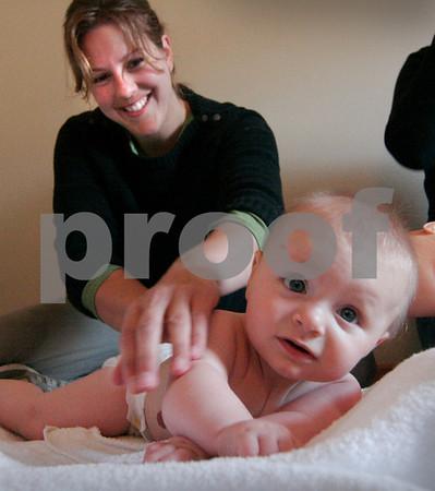 Newburyport:<br /> Megan Taffel gives a massage to her baby, Calli.<br /> Photo by Ben Laing/Newburyport Daily News Thursday, October 30, 2008
