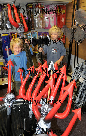 Salisbury:<br /> Henry Weese, 7, right, of Newbury and his brother, Holden, 5,  look at devishish pitchforks at Funny Bones in Salisbury as they and their mother, Sarah, browse for some last minute Halloween shopping.<br /> Photo by Bryan Eaton/Newburyport Daily News Wednesday, October 29, 2008