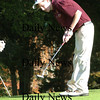 Newbury:<br /> Newburyport's Ben Tyler putts on the eighth hole in River Rival action.<br /> Photo by Bryan Eaton/Newburyport Daily News Tuesday, October 14, 2008