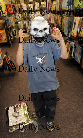 Salisbury:<br /> Henry Weese, 7, of Newbury tries on a ghoulish costume at Funny Bones in Salisbury as he and his brother, Holden, 5, and mother, Sarah, do some last minute Halloween shopping.<br /> Photo by Bryan Eaton/Newburyport Daily News Wednesday, October 29, 2008