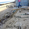 Newbury:<br /> Ian Armour removes decking at 6 Northern Boulevard on Plum Island as the sand has fallen away underneath.<br /> Photo by Bryan Eaton/Newburyport Daily News Thursday, October 30, 2008