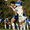Newburyport:<br /> Newburyport's Yazid Eideh goes up with Methuen's Gagne yesterday at Cherry Hill Field.<br /> Photo by Bryan Eaton/Newburyport Daily News Thursday, October 30, 2008