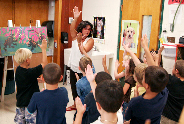 "Newburyport: Students in Mrs. Jamison's art class at the Bresnehan School move like different animals from the childrens book ""The Tall, Tall Grass"", before they get started on creating their own art projects. Photo by Ben Laing/Newburyport Daily News Monday September 15, 2008."