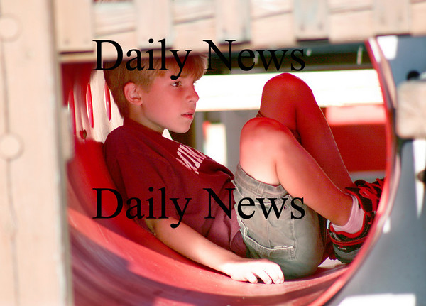 Amesbury: Holden Bateman, 9, of Amesbury, hangs out in at tube on the jungle gym at the Amesbury Town Park Monday afternoon. Photo by Ben Laing/Newburyport Daily News Monday September 8, 2008.