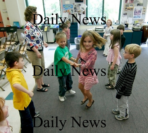Newbury: Mrs. Mollineaux's first graders practice a dance Monday afternoon in Mrs. Peterson's music class at Newbury Elementary School. Photo by Ben Laing/Newburyport Daily News Monday September 28, 2008.