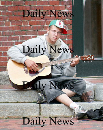 Amesbury: Eric Grongin of Amesbury plays his guitar while enjoying the nice weather in downtown Amesbury Thursday afternoon. Photo by Ben Laing/Newburyport Daily News Thursday September 25, 2008.