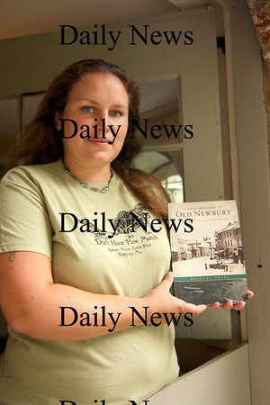 Newbury: Local author, Bethany Groff, stands in the doorway at the Spencer Pierce Little Farm with a copy of her new book, A Brief History of Old Newbury. Photo by Ben Laing/Newburyport Daily News Friday September 12, 2008.