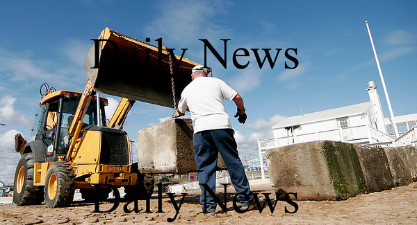 Newbury: DPW workers place concrete blocks along the edge of the Plum Island Center parking lot Monday morning after the past weekends storm caused some severe erosion along the beach. Photo by Ben Laing/Newburyport Daily News Monday September 29, 2008.