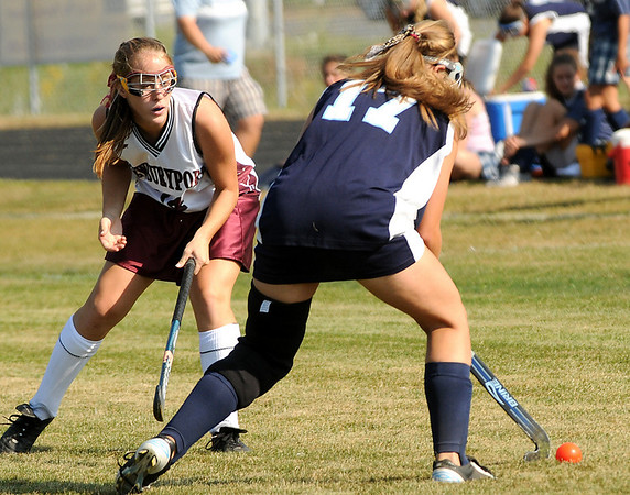 Newburyport: Newburyport's Rachel Notargiacomo defends Triton's Sara Plan during Friday's field hockey game at Fuller Field. Photo by Ben Laing/Newburyport Daily News Friday September 05, 2008.