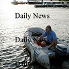 Newbury: Newbury resident, Chris Muse, commutes from one bank of the Parker River to the other by boat, rather than taking the more common detour through Rowley by car. Photo by Ben Laing/Newburyport Daily News Friday September 5, 2008.