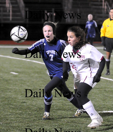 Lynn: Laura Muise (25) tries to outrace Cohasset's Mackenzie Hart (7) to the ball during Tuesday night's Eastern Mass. Final in Lynn. Photo by Ben Laing/Newburyport Daily News Tuesday November 18, 2008.