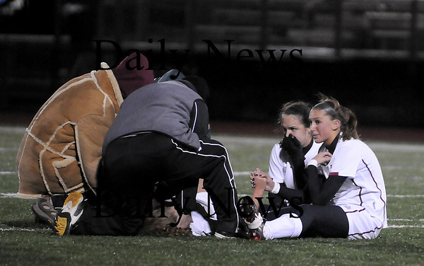 Lynn: Fellow co-captains Jillian Kinter, right, and Laura Muise, left, comfort Taylor Bresnahan after she was injured in the first half of Tuesday night's game against Cohasset. Taylor had to watch from the sidelines as the Clippers eventually sealed the victory with a goal in double overtime. Photo by Ben Laing/Newburyport Daily News Tuesday November 18, 2008.