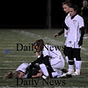 Lynn: Jillian Kinter kneels over fellow captain Taylor Bresnahan as she lays injured on the field during Tuesday nights Eastern Mass. Finals game against Cohasset. Photo by Ben Laing/Newburyport Daily News Tuesday November 18, 2008.
