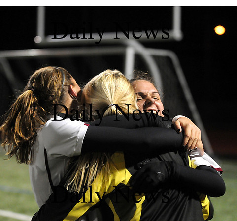 Lynn: Captain's Laura Muise, left, and Jillian Kinter, right, hug goalkeeper Lindsey Tomasz, who posted a shut out in Newburyport's 1-0 double overtime win over Cohasset Tuesday night. The Clippers advance to the state finals. Photo by Ben Laing/Newburyport Daily News Tuesday November 18, 2008.