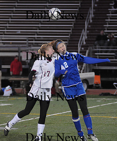 Lowell: Avery Cullinan goes up for a header with a Bedford player during  their game  at Crowley Stadium in Lowell. The Clippers beat Bedford 2-1 in OT  giving them their 3rd straight North Sectional Title. photo by Jim Vaiknoras/Newburyport Daily News Sunday November 16, 2008