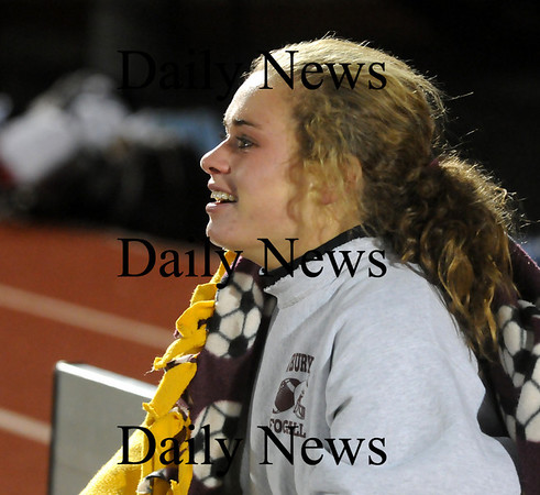 Lynn: Senior co-captain Taylor Bresnahan has tears in her eyes after watching her teammates defeat Cohasset 1-0 in double overtime. Bresnahan had to leave the game mid-way through the first half after suffering a leg injury. Photo by Ben Laing/Newburyport Daily News Tuesday November 18, 2008.