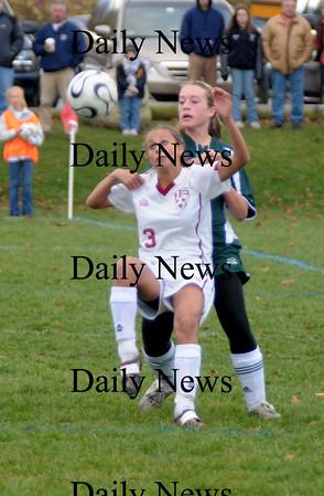 Newburyport:Newburyport's Micaela Hogan makes a play on the ball against North Reading at Cherry Hill. Newburyport won teh game 2-0.photo by Jim Vaiknoras<br /> /Newburyport  Daily News. Sunday November 8, 2008