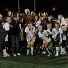 Retiring Newburyport soccer coach and teacher Ken Siegel with the 2008 North sectional champion Clippers at Cawley Stadium in Lowell after the team defeated Bedford, 2-0 Sunday night. PHOTO BY JIM VAIKNORAS