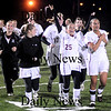 Lynn:Newburyport 's Laura Muise celebrates with her team after their 1-0 victory over Lynnfield at Manning Field in Lynn Thursday night.photo by Jim Vaiknoras/Newburyport Daily News. Thursday November 13, 2008.