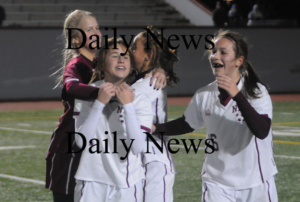 Lowell: The Newburyport girl soccer team celebrate after winning their 3rd straight North Sectional Title at Crowley Stadium in Lowell. The Clippers beat Bedford 2-1 in OT. photo by Jim Vaiknoras/Newburyport Daily News Sunday November 16, 2008