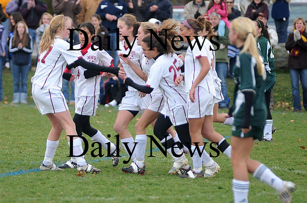 Newburyport: Newburyport High girls soccer team celebrates it's second goal against North Reading Tuesday at Cherry Hill in Newburyport. The Clippers won the game 2-0.photo by Jim Vaiknoras<br /> /Newburyport  Daily News. Sunday November 8, 2008