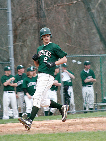 West Newbury: Pentucket's Chris Modlish (2) crosses home plate after an error by Manchester-Essex during a rain soaked game in West Newbury. Photo by Ben Laing/Staff Photo