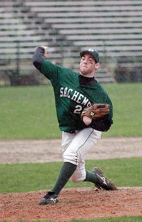 West Newbury: Sachem's pitcher, Adam Newell (sp?) (22), delivers during a rain soaked game against Manchester-Essex at Pentucket. Photo by Ben Laing/Staff Photo